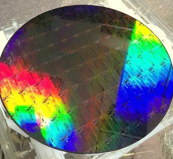 https://en.wikipedia.org/wiki/Silicon_photonics#/media/File:Silicon_Photonics_300mm_wafer.JPG